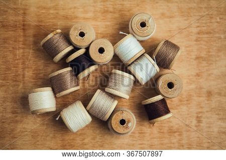 Set Of Thread On Wooden Background, Flat Lay, Top View