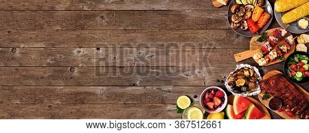 Summer Bbq Or Picnic Food Corner Border Over A Rustic Wood Banner Background. Assorted Grilled Meats