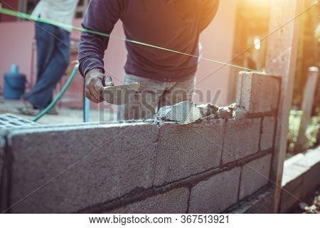 Bricklayer Building A Brick Wall Or Wall Construction.