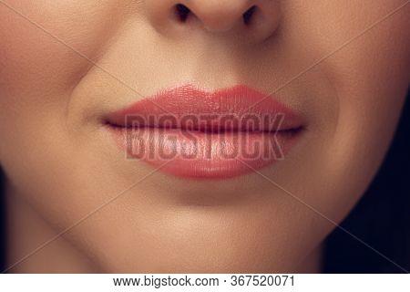Close Up Of Beautiful Female Face, Lips With Stylish Make Up Isolated On Grey Studio Backgroud. Beau