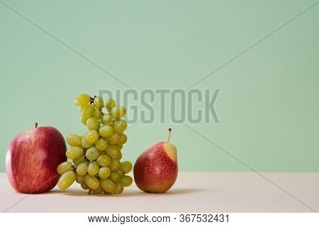 Mellow Summer Bunch Of Grape Red Apple And Pear. Healthy Lifestyle Concept. Copy Space. Isolated On