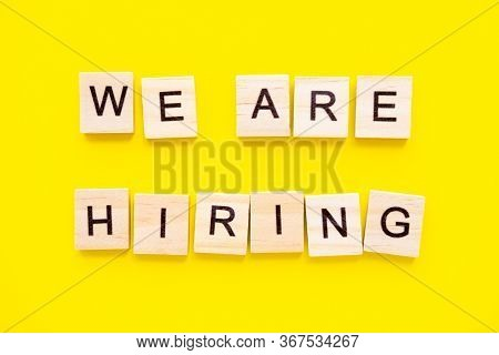 Words We Are Hiring On Yellow Background. Job Board. Human Resource Management And Recruitment And H