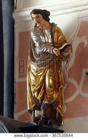 ZAGREB, CROATIA - MAY 16, 2013: Saint Luke the Evangelist, altar of the Holy Spirit in the Church of Saint Catherine of Alexandria in Zagreb, Croatia
