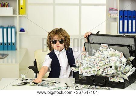 Cash. Happy And Shoutting Arrogant Rich Kid Boy Millionaire Sits With Money Dollars Cash. Money. Ric