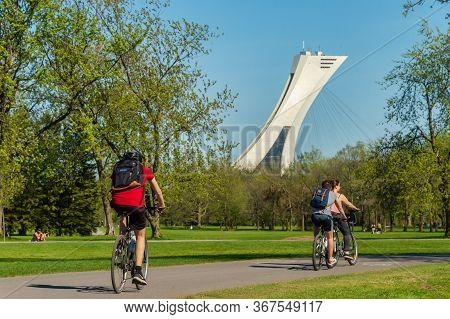 Montreal, Ca - 22 May 2020: People Riding Bikes In Parc Maisonneuve During Covid 19 Pandemic. Olympi