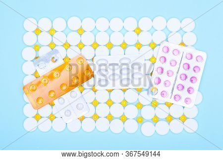 Pile Of Medical Supplies, Pills, Capsules And Tablets, On The Background Of Round Pills.various Medi