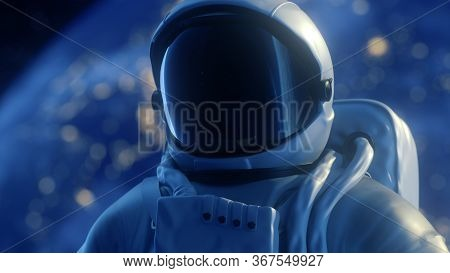Portrait Alone Astronaut Looks At The Planet Earth In Orbit In Outer Space, The Planet Earth Reflect