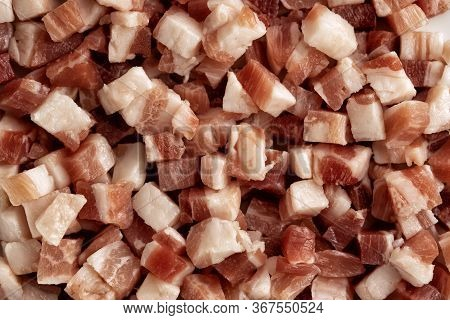 Italian Pancetta, Bacon Cubes, Diced Ham, Cutted Pork Texture Background. Cooking Ingredient For Pas