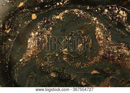 Gold (bronze) glitter shine dots on black. Abstract light blink sparkle backgound
