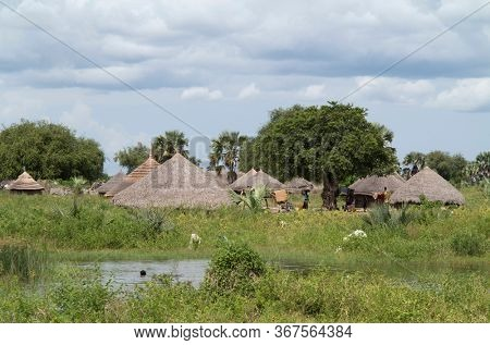A traditional village along the White Nile river in South Sudan south of Bor.