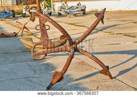Old Rusty Four-legged Anchor In The Seaport Anapa