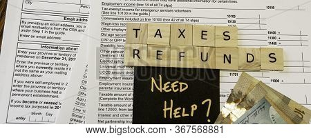 New Canadian Personal Tax Forms And Letter Tiles Showing Refunds And Taxes For Taxes And Refunds - B