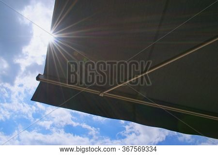 Sunprotecting Awning From Fabric Material, Sky And Sunlight