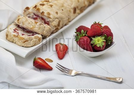 Meringue Roll With Cream And Strawberries. Meringue Roulade, Roasted Almonds With Nuts. Summer Desse