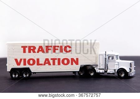 Traffic Violation Word Concept Written On Board A Lorry Trailer On A Dark Table And Light Background