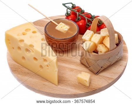 Yellow Maasdam Cheese, Triangular Piece Cheese With Holes, Saucer With Honey, Tomato, Basket Of Chee