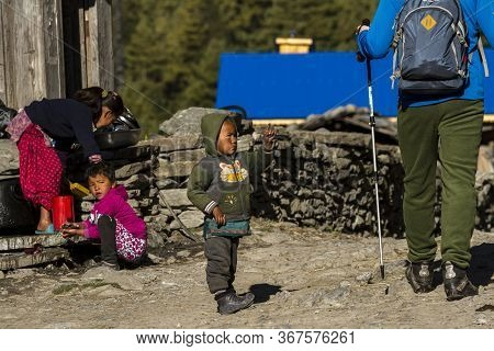 Annapurna, Nepal - November 8, 2015: Nepalese Children See The Tourist In A Village Along The Annapu