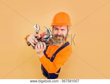 Repairment Tools. Industrial Worker. Repair. Smiling Worker Holds Repair Tools. Building. Industry.