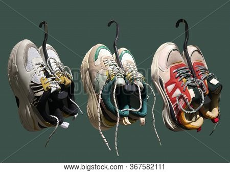 White Platform Sneakers With Bright Color Accents On A Hanger Pattern On Dark Green Background. High