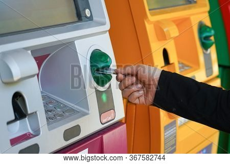 Woman's Hand Using Credit Card To Withdrawing Or Transfer Money From Atm Machine.finance, Money, Ban