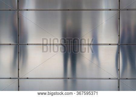 Sketchy Shadows On The Matt Metal Façade Of An Office Building In The Hafencity, Hamburg.