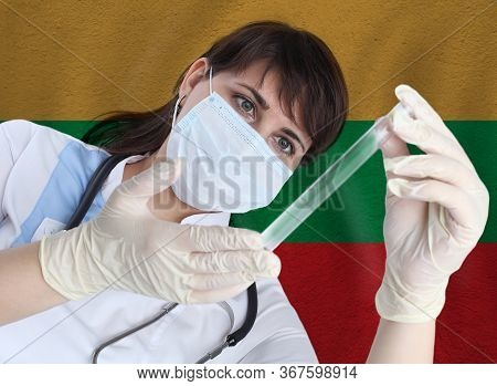 Scientist Woman With Test Tube Coronavirus Or Covid-19 Against Lithuania Flag. Research Of Viruses I