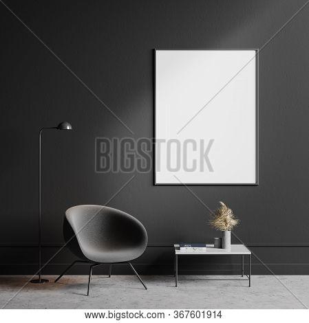 Interior Of Minimalistic Living Room With Dark Grey Walls, Concrete Floor, Comfortable Gray Armchair