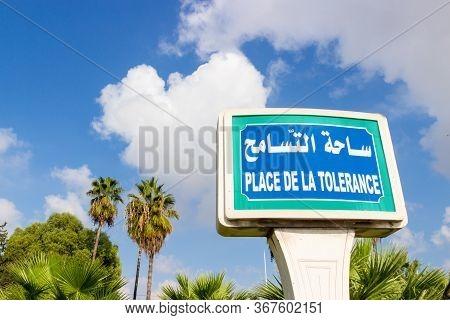 Urban Pointer Sign 'place De La Tolerance' On Sky Background In Tunis, Tunisia. Inscriptions In Fren