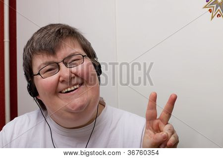 a sitting mentally disabled woman is listening to music poster