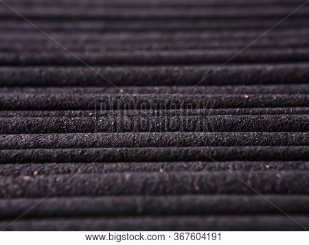 Macro-photography Of Incense Sticks Row Laid Out In An Even Layer. Brown Incense Sticks Longitudinal