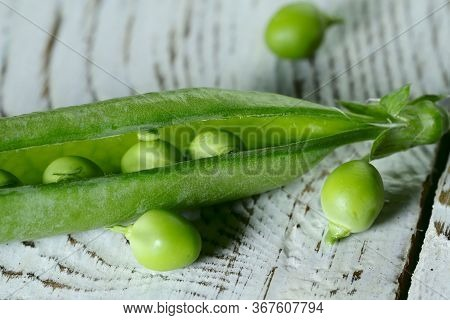 Food Background. Close-up Of A Green Pea Pod. Texture Of A Green Pea Pod. Side View, Close Up, Free