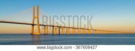 Suspension Vasco Da Gama Bridge Over The Tagus River In Lisbon, Portugal.