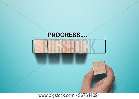 Hand Putting Wooden Cube On Virtual Infographic Rectangle Block With Progress Wording. Job Progressi