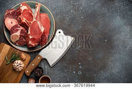 Assorted Meat Cuts And Steaks, Rustic Meat Cleaver, Seasonings And Herbs. Beef Steak Tomahawk, Veal