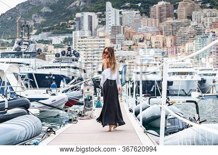 Monaco, Monte-carlo, 27 September 2019: The Elegant Girl Dressed In An Evening Dress Of Black Color