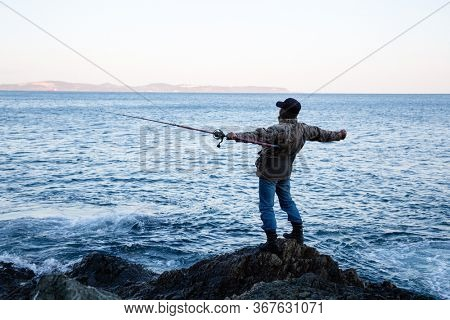 Fisherman admires the open spaces in the early morning