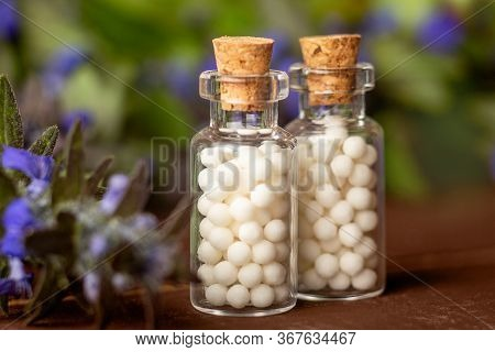 Homeopathic Medicine Concept. Homeopathy Pills In Vintage Bottles, Medical Herbs, Close Up