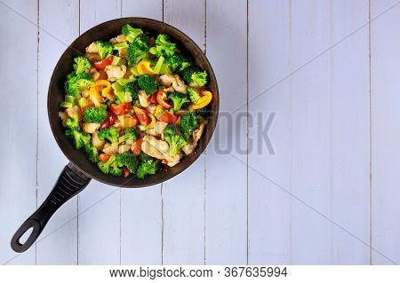 Stir Fry Vegetables With Chicken On Pan. Top View.