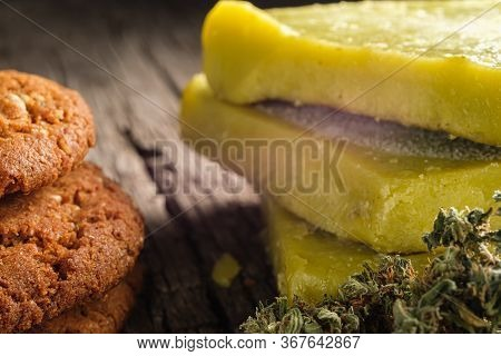 Biscuits With Marijuana And Cannabis Butter And Bud On An Old Wooden Background Close-up. Healthy Me