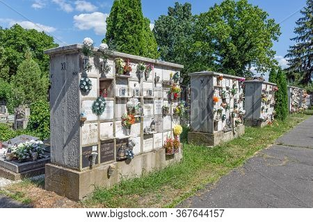 Eger , Hungary - July 08, 2019: Columbarium With Flowers In An Hungarian Cemetery