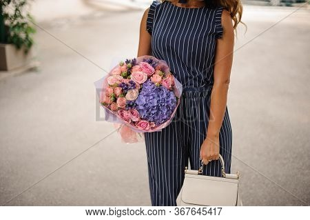 Magnificent Bouquet Of Pink Roses And Purple Hydrangea In The Girls Hand