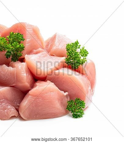 Raw Chicken  Breast Fillet Chunks With Parsley Herb Isolated On White