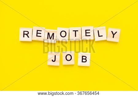 Words Remotely Job. Wooden Blocks With Lettering On Top Of Yellow Background. Human Resource Managem
