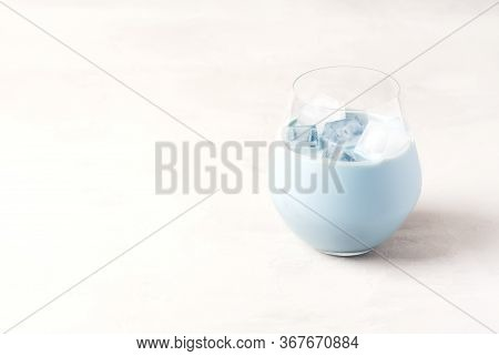 Ice Latte With Blue Butterfly Pea Colors. A Cold Blue Matcha Latte Is Standing In A Glass With Ice C