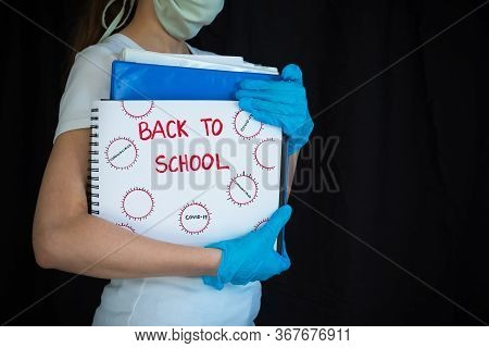 Student Wearing Face Mask And Surgical Gloves And Holding School Books With Back To School Written O