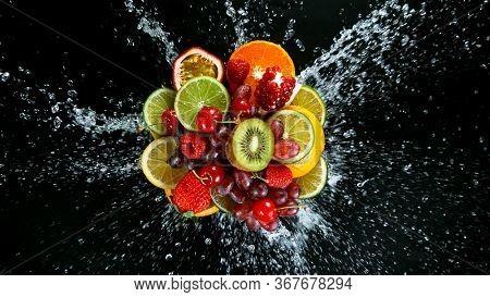 Super Slow Motion Shot of Fresh Fruits with Splashing Water Isolated on Black Background.