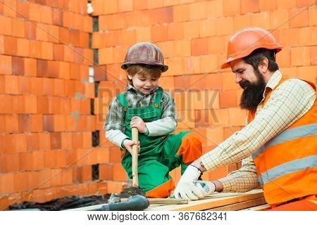 Builders Technician And Engineers With Buiding Tools. Professionals Team Workers Set In Safety Helme