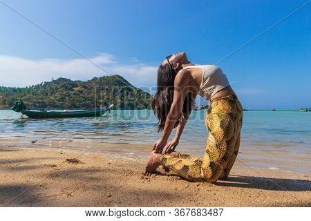 Asian Thai Woman Practicing Yoga At Evening In Haad Chaloklum Beach, Koh Phangan Island, Thailand. C