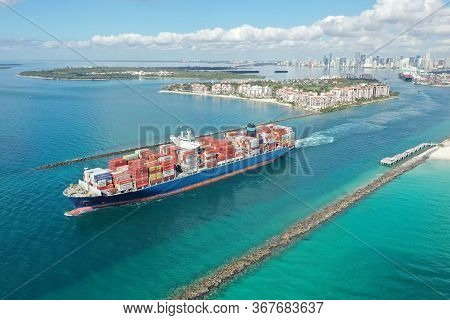 Miami Beach, Florida - May 23, 2020 - Aerial View Of Container Ship In Government Cut Leaving Port M