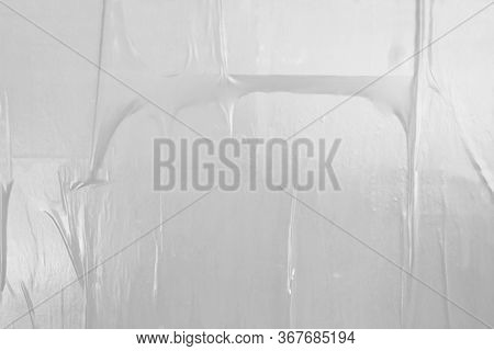 Grungy Adhesive Poster Paper With Ripples, Air Pockets And Wrinkly Uneven Texture